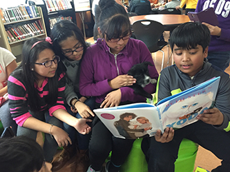 read-across-america-ms-88-library-read-to-dogs